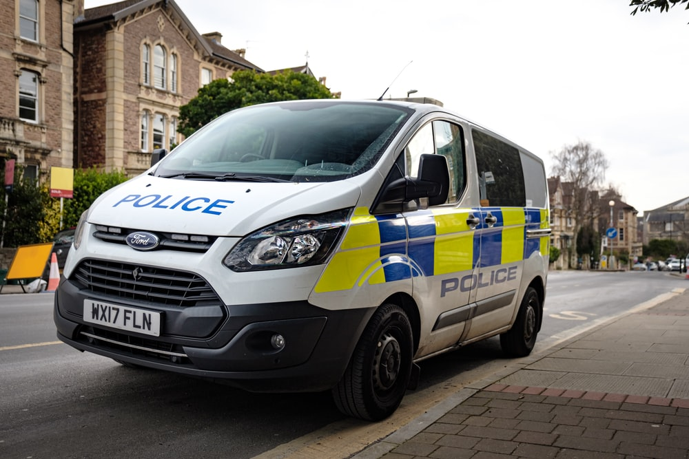 white and blue police car