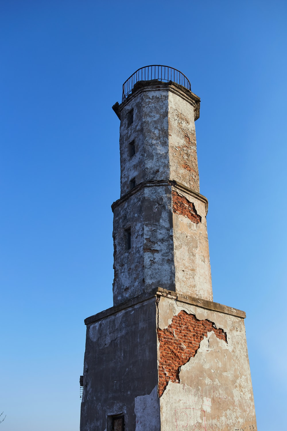 brown concrete tower under blue sky during daytime