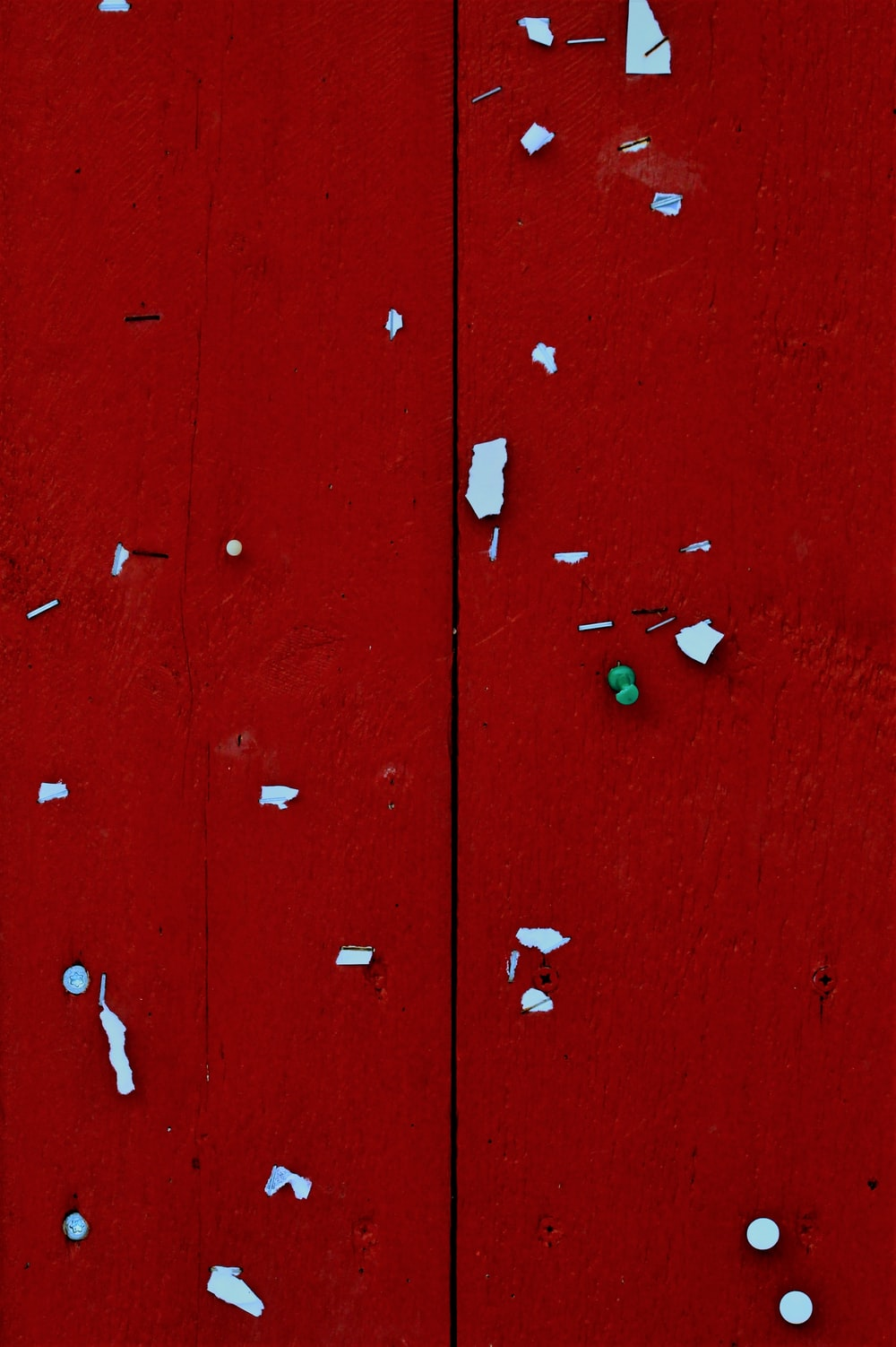 red wooden door with white heart shaped