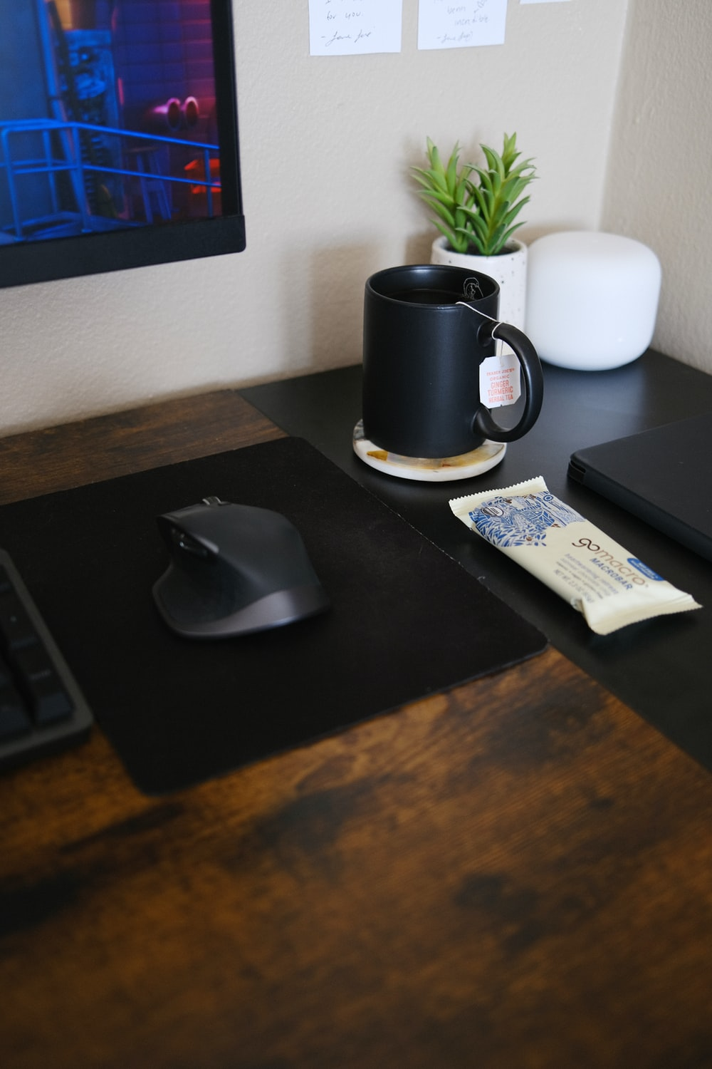 black and silver cordless computer mouse beside black laptop computer