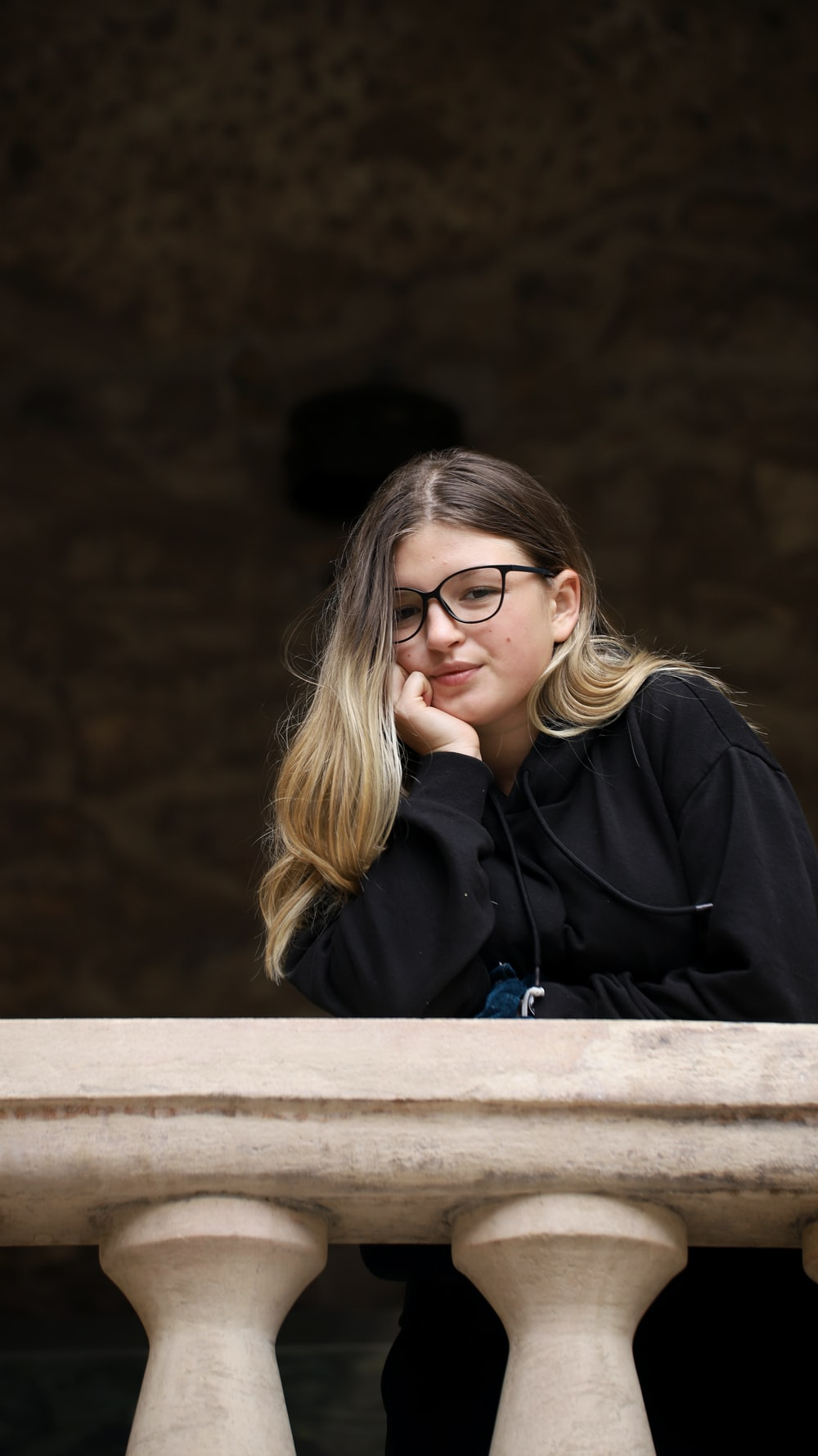 woman in black jacket wearing eyeglasses