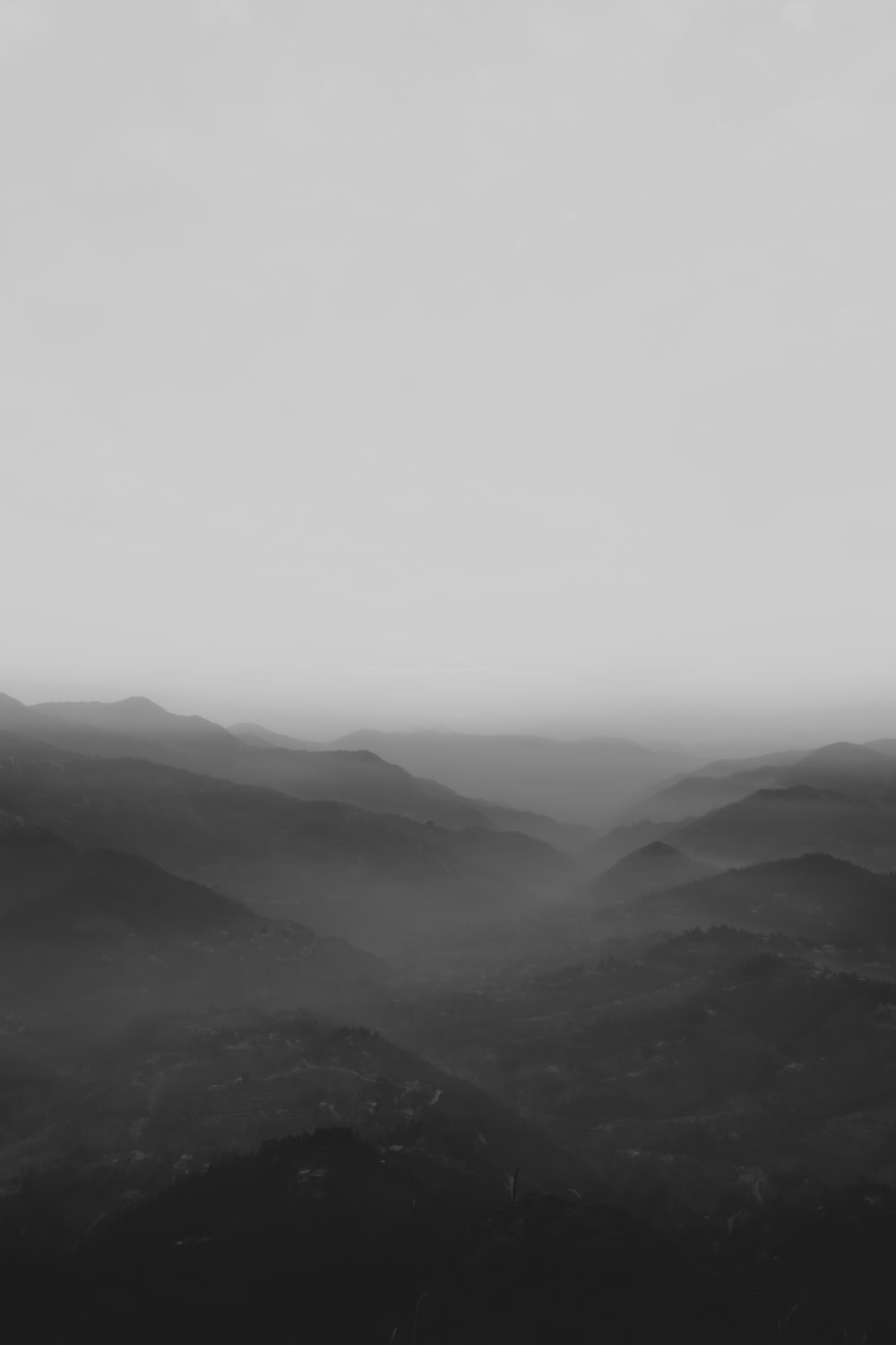 mountains covered with fog during daytime
