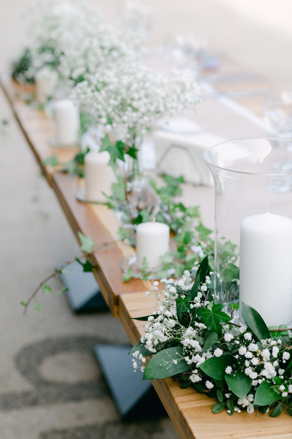 white pillar candle on brown wooden table