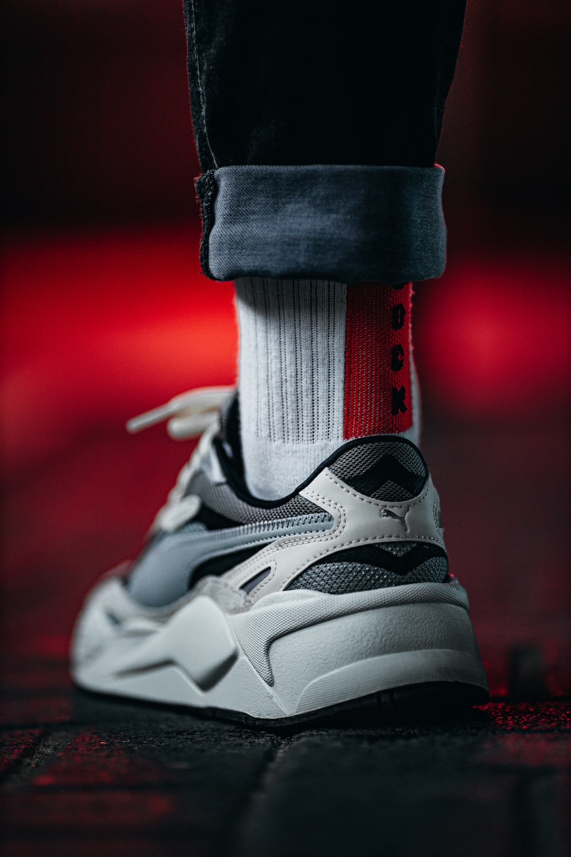 white and black nike athletic shoe
