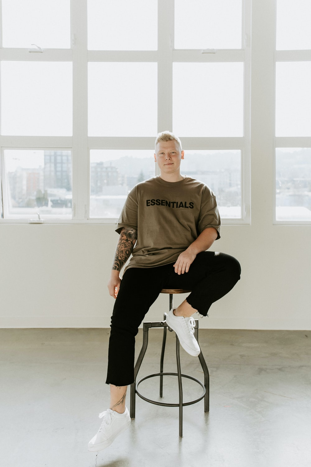 man in brown crew neck t-shirt sitting on black chair