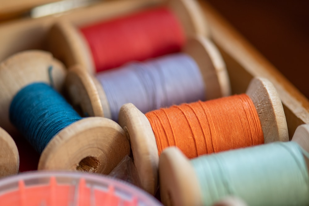 red blue and white thread spool
