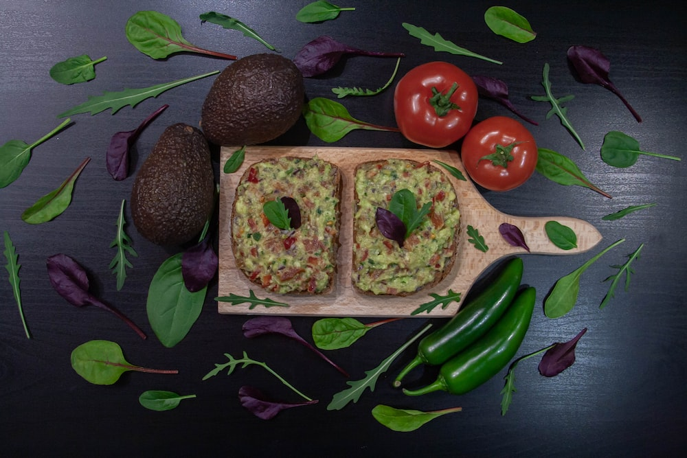 two brown and green food on purple and green floral textile