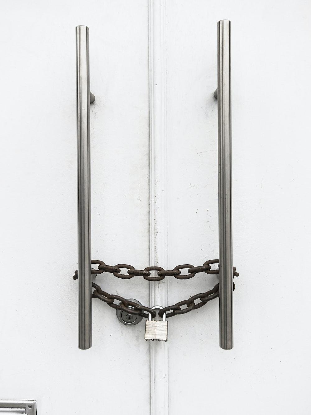 silver chain on white wooden door