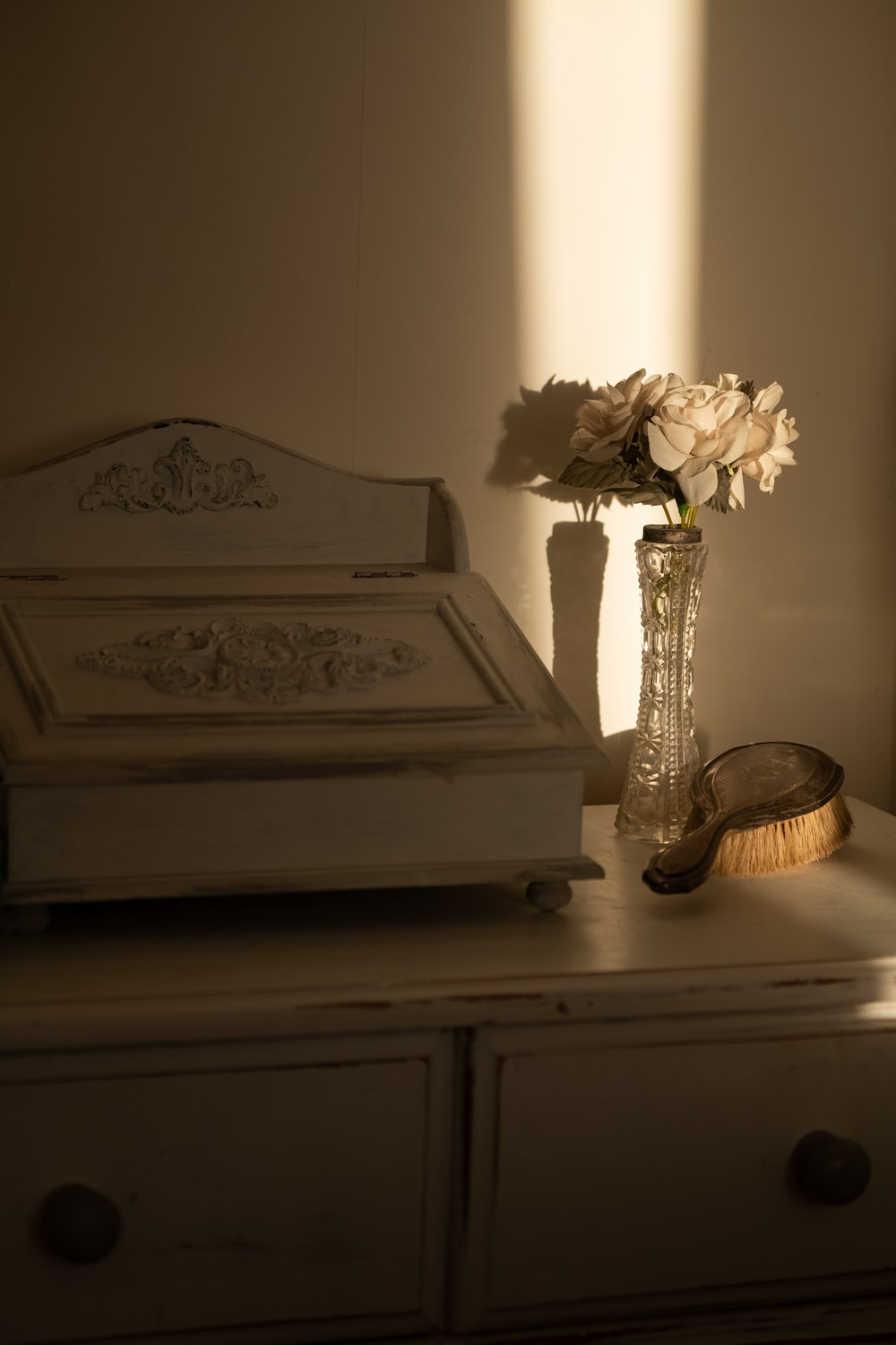 white floral table lamp on brown wooden table