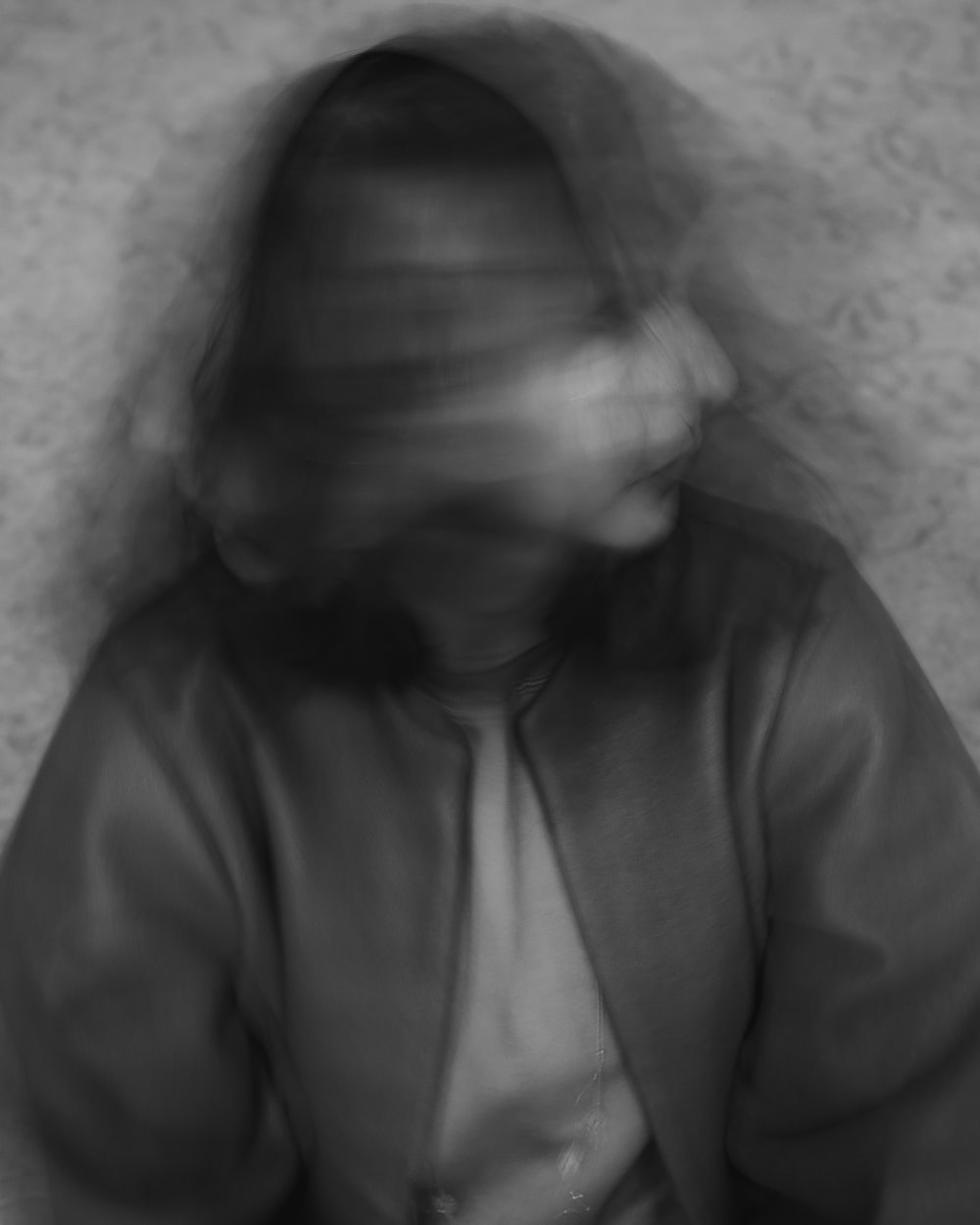 grayscale photo of woman in button up shirt