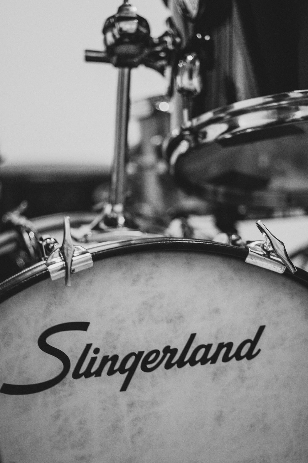 grayscale photo of drum set