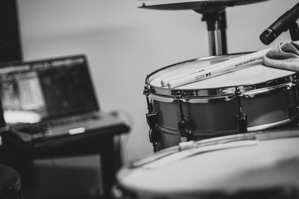 grayscale photo of drum kit