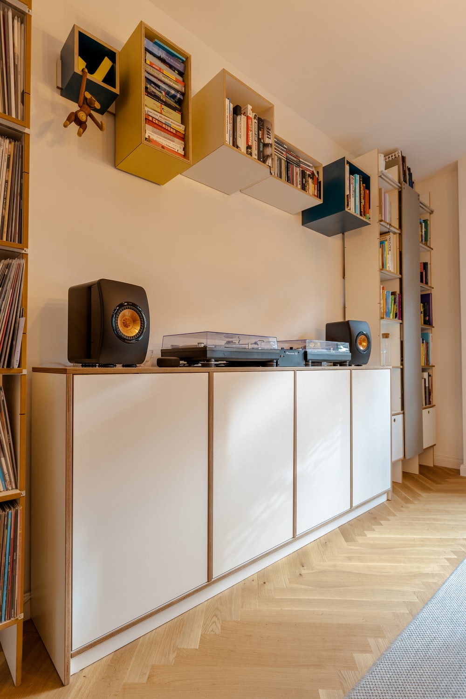 black speaker on white wooden cabinet
