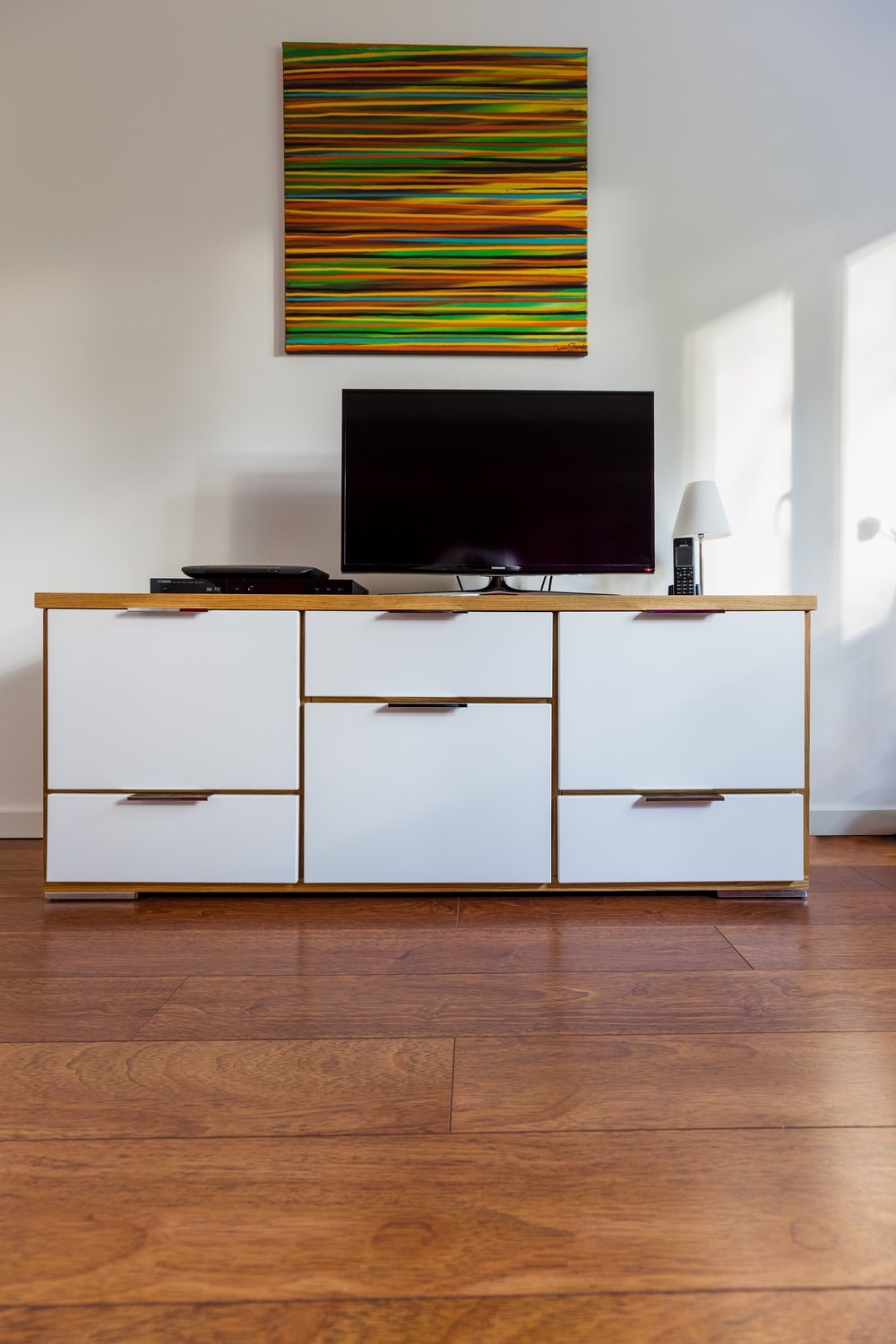 black flat screen tv on white wooden cabinet