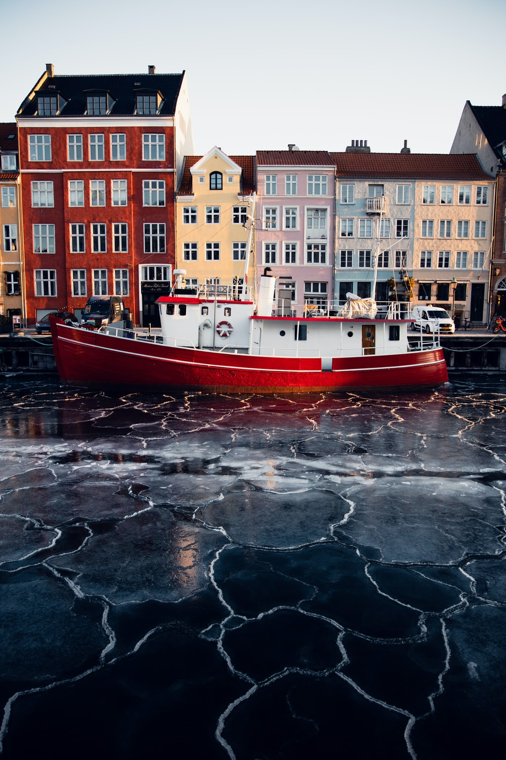 red and white boat on water