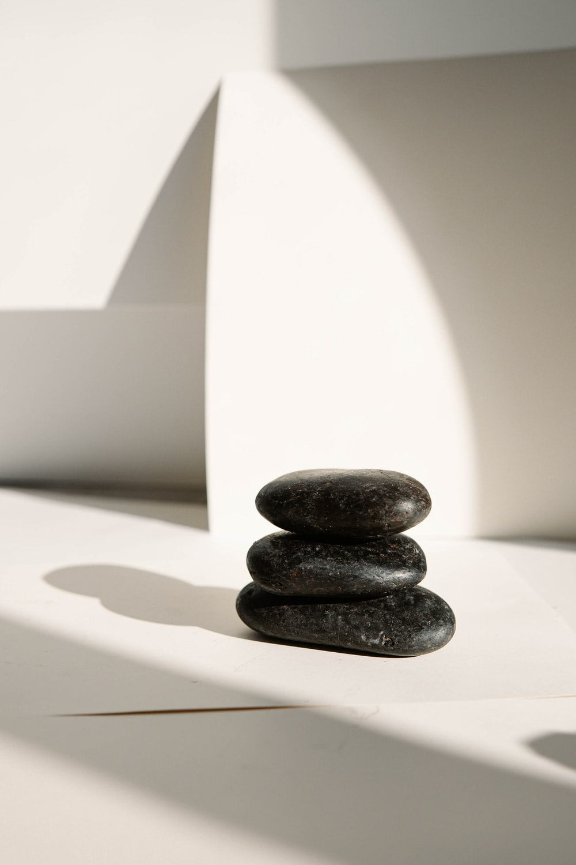 black stones on white table