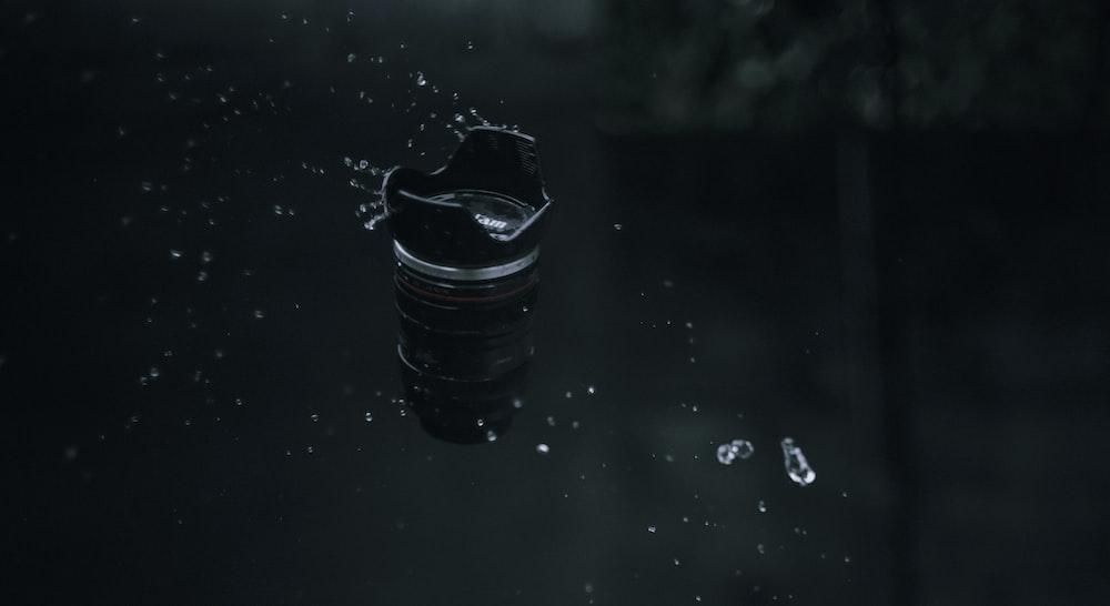 black plastic cup on black table