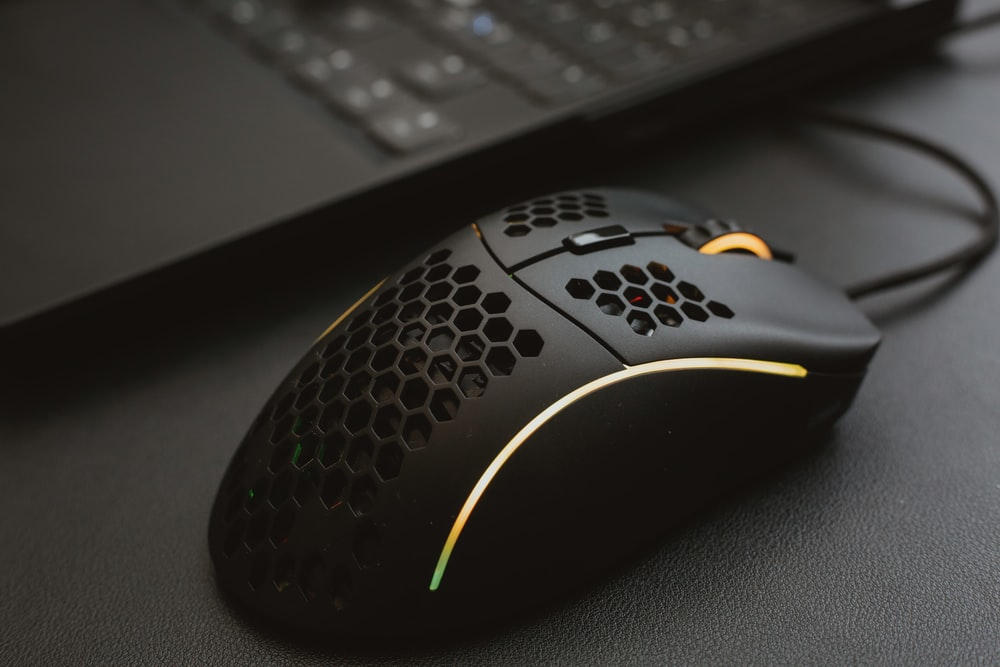black and yellow logitech computer mouse