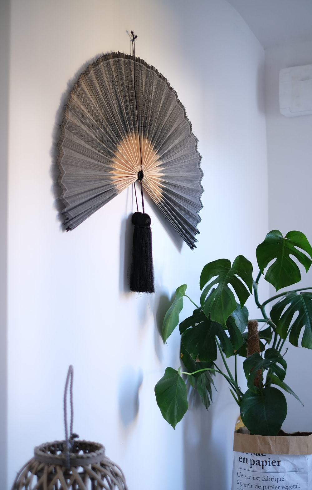 brown and black hand fan