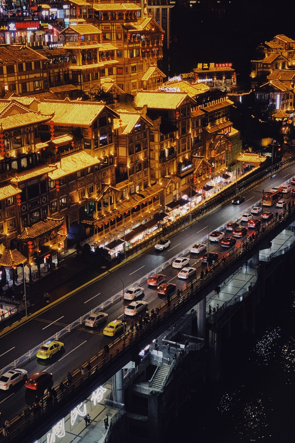 cars on road near buildings during night time