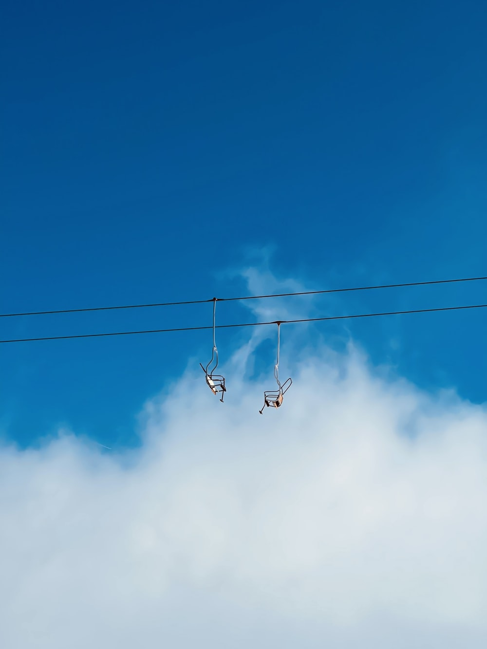 black cable car under blue sky during daytime