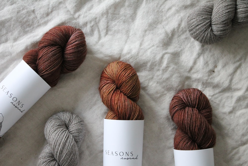 gray yarn on white textile