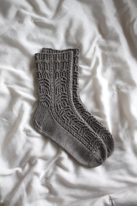 gray sock on white textile