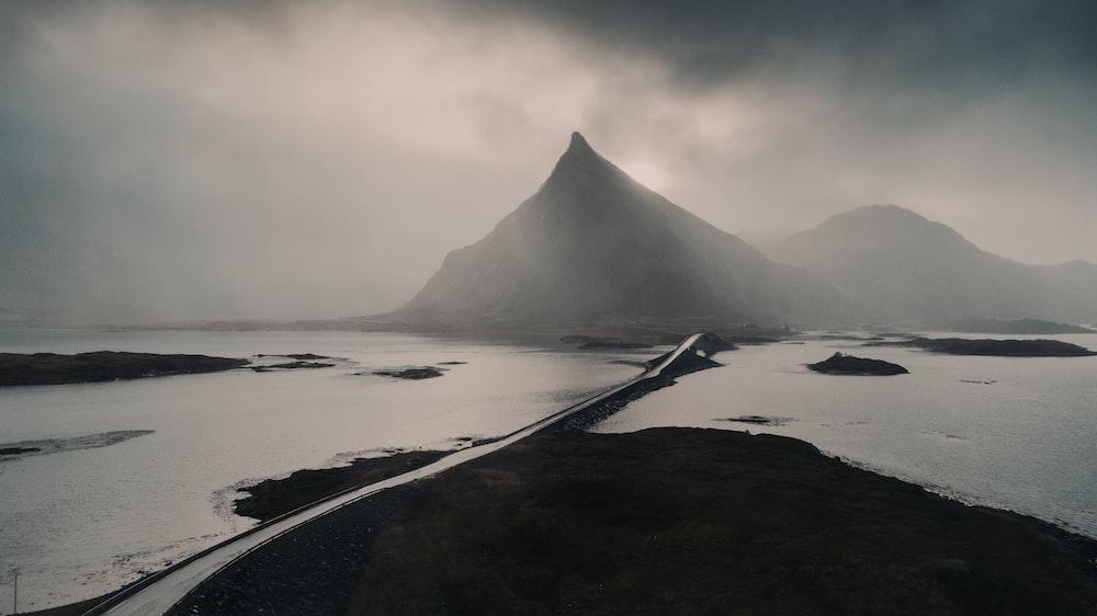 black mountain near body of water during daytime