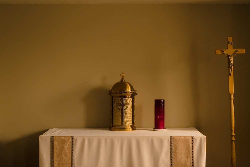 gold and white dome on white table