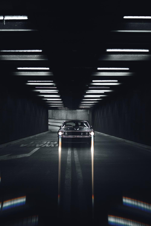 black sports car on tunnel
