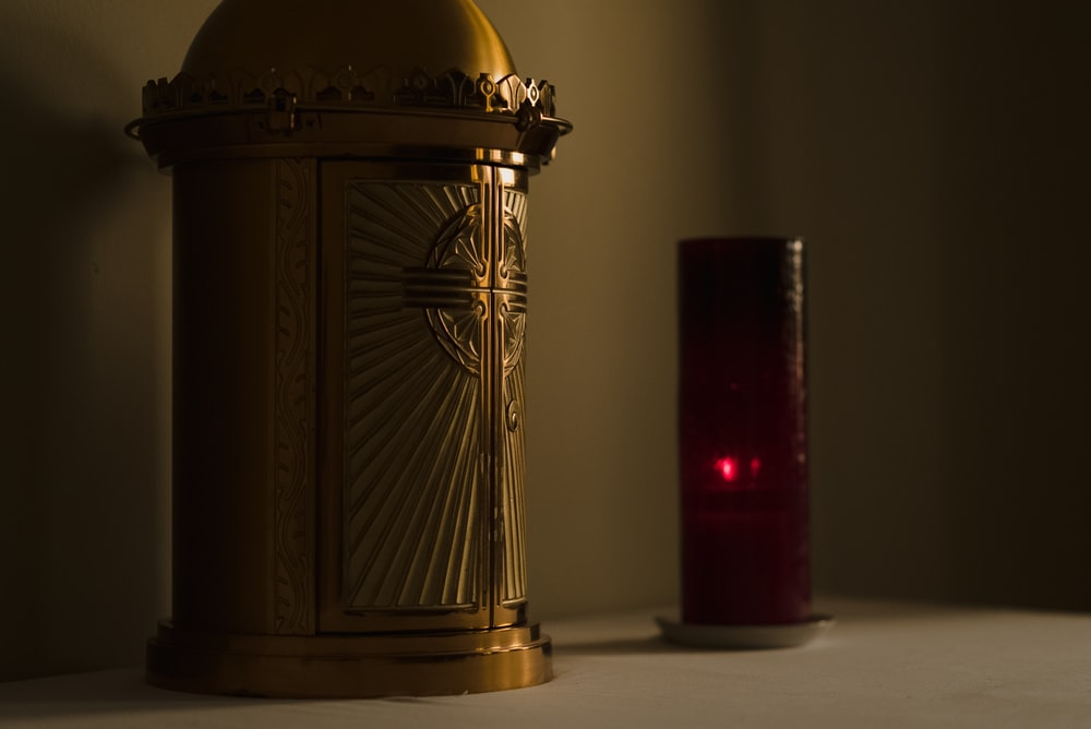 brown wooden lantern on white table
