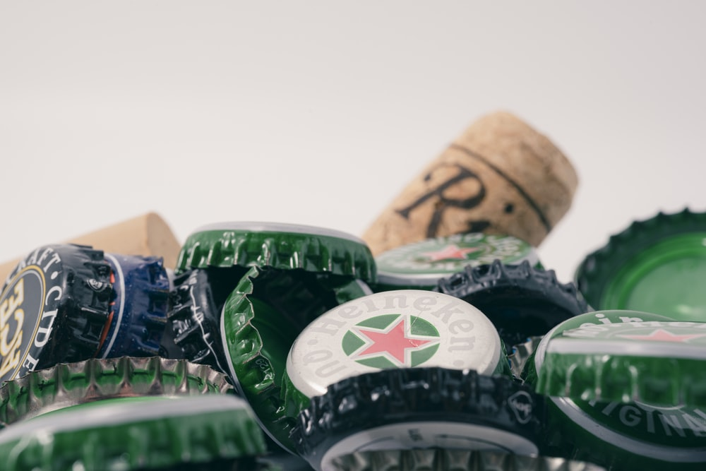 green and white bottle cap