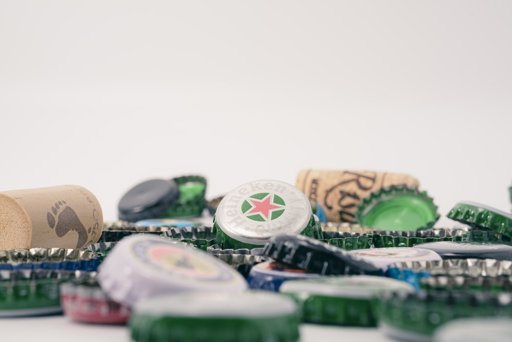 green and brown bottle cap