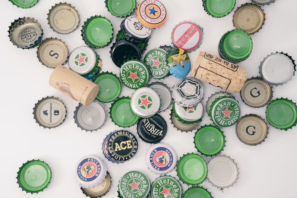 assorted bottle cap on table