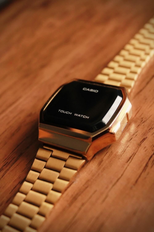 gold link bracelet black and gold square watch
