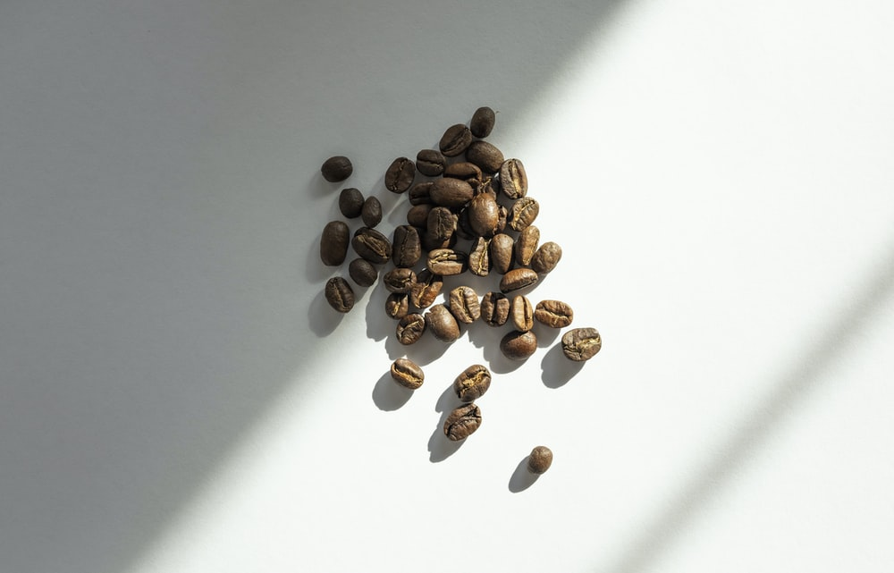brown coffee beans on white table