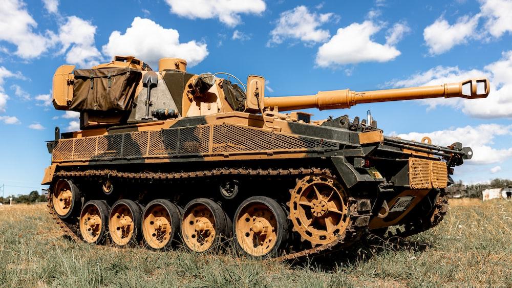 battle tank under blue sky during daytime