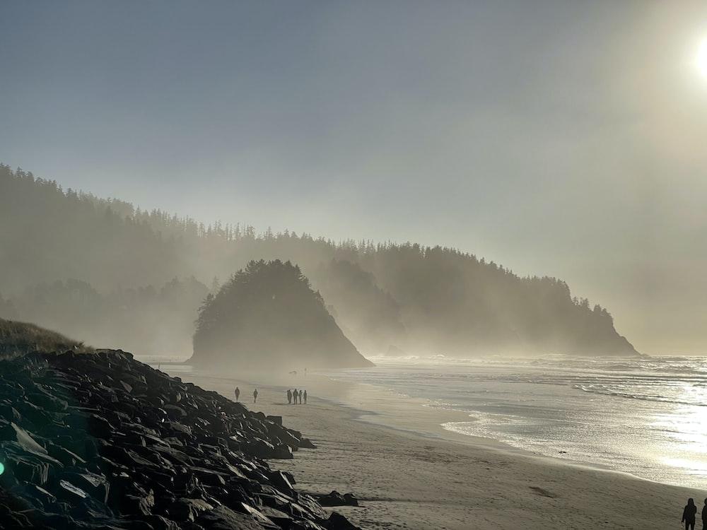 sea waves crashing on rocks during daytime