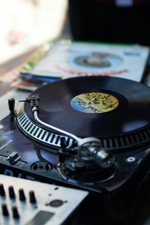 black vinyl record player on white table