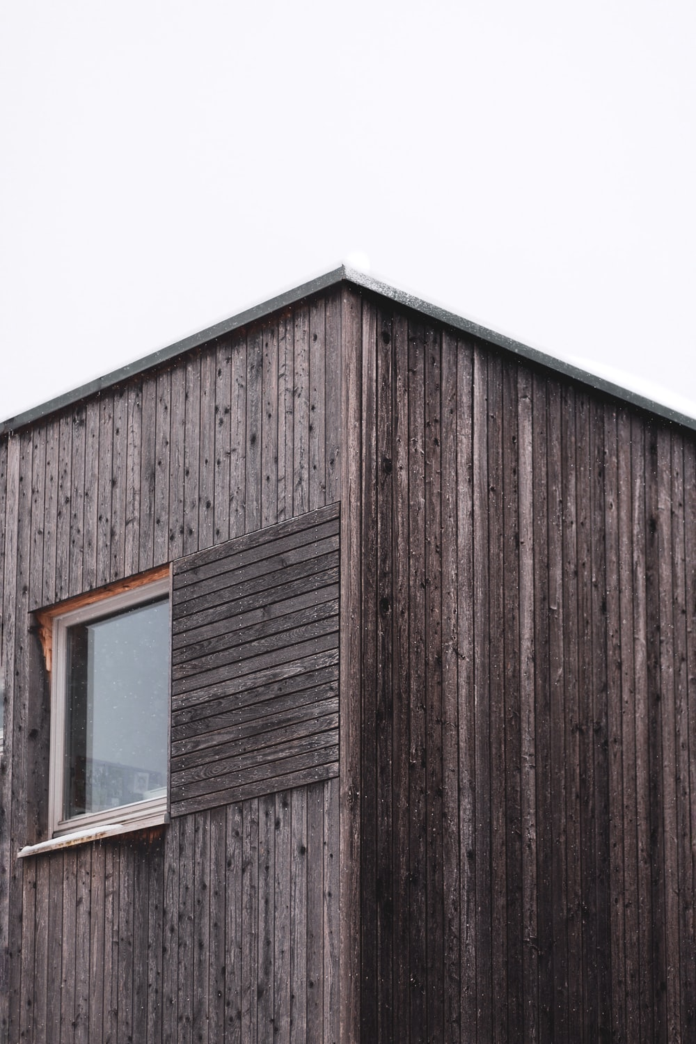 brown wooden house under white sky during daytime