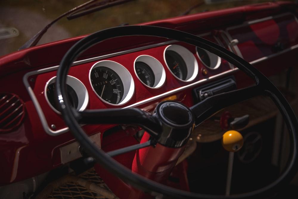 black and red car steering wheel