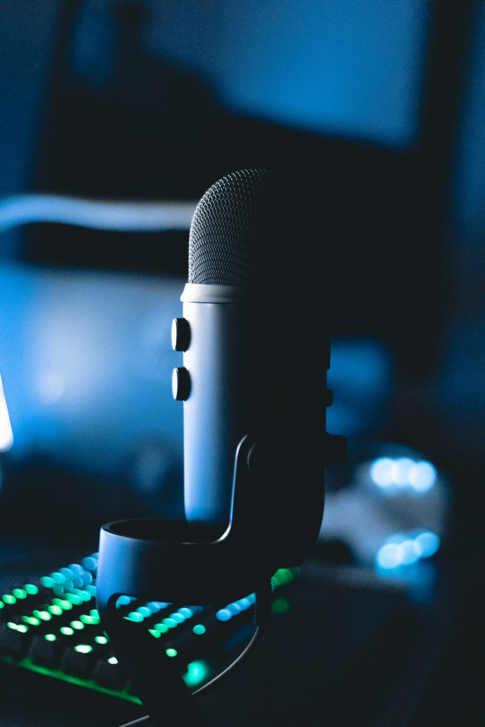 black microphone on blue and white polka dot textile