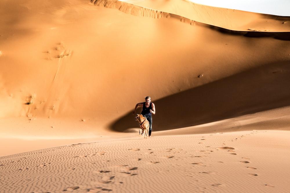 man in black jacket riding on white bicycle on desert during daytime