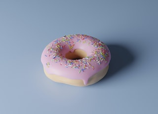 pink and white doughnut on white surface