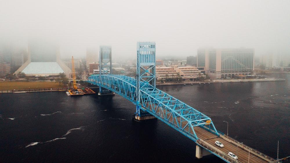 gray bridge over river during daytime