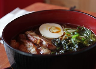 soup dish on black ceramic bowl