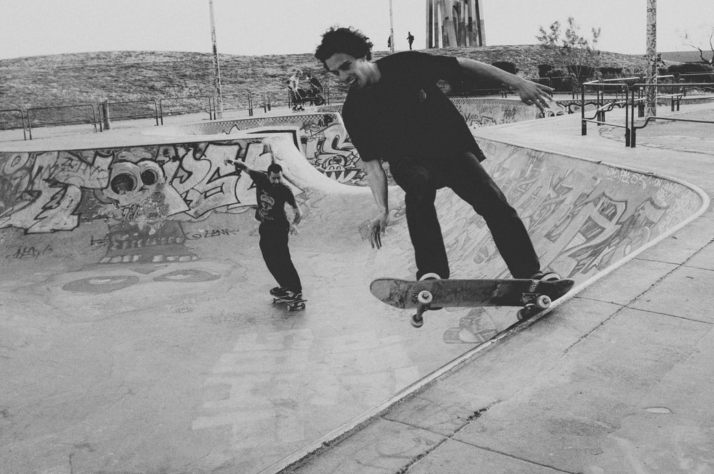 man in black jacket and pants riding skateboard