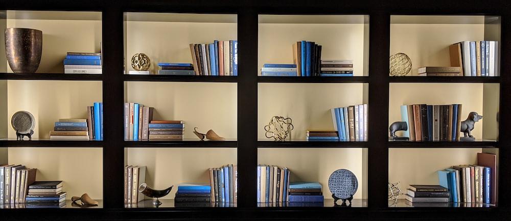 books on black wooden shelf