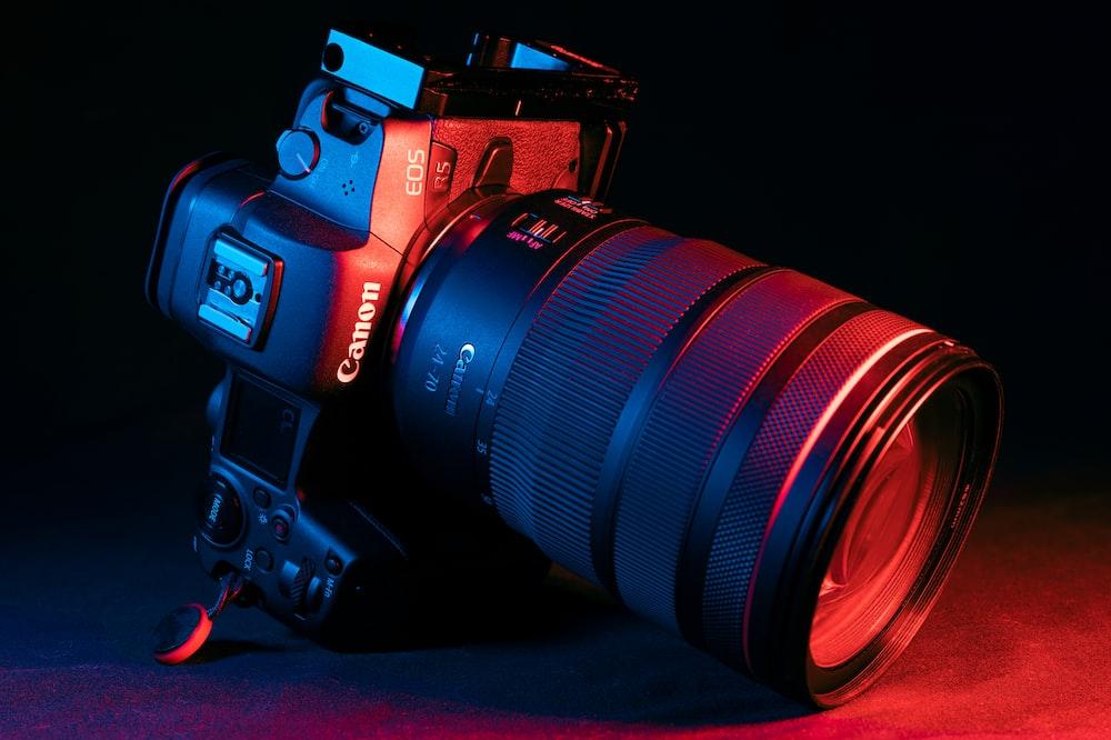 black nikon dslr camera on red textile
