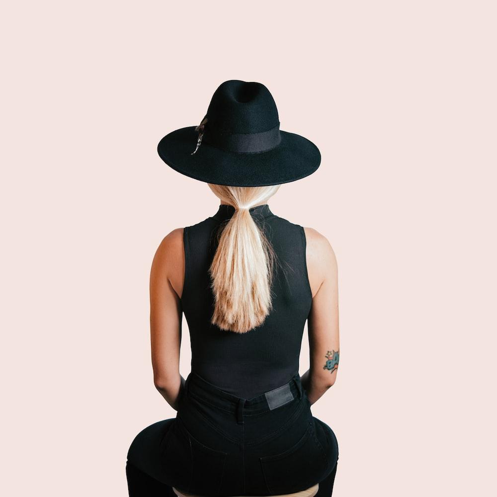 woman in black tank top wearing black hat